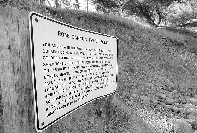 Tecolote Park. The sign explains that the tan and cantaloupe-colored rock on the left side of the fault is 50-million-year-old Eocene sandstone, while the putty-colored conglomerate on the right was formed only a half-million years ago.