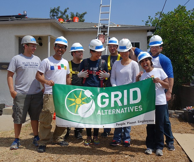 The idtDNA volunteer team who installed Mrs Marshall's solar electric system.