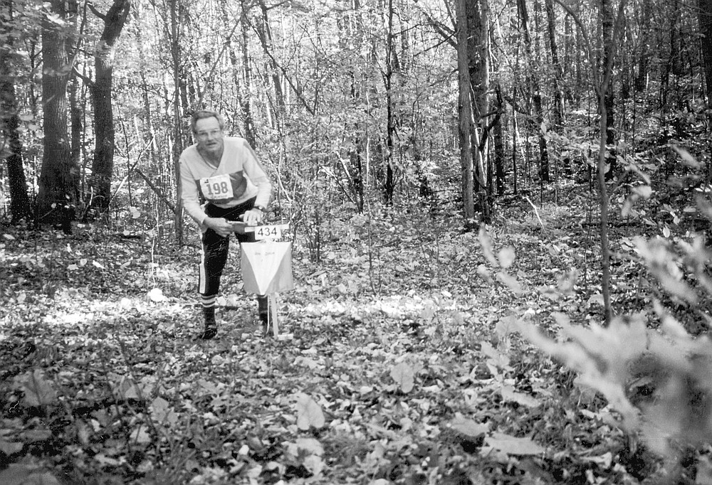 "Bill Gookin at the World's Veterans Cup Championship, 1999. ""The orienteer is relating to his environment and how he feels. The runner tries to blank out how he feels."""