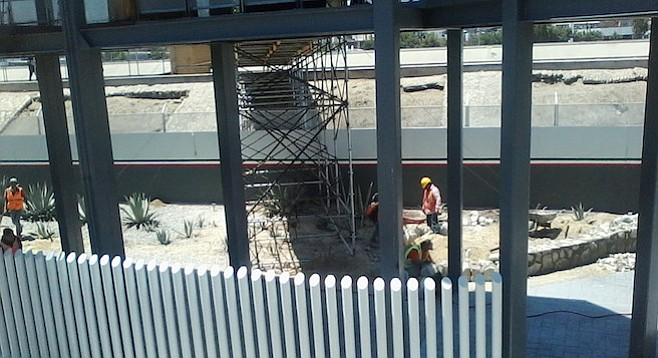 Construction of a permanent walkway continues on the Mexican side of the border