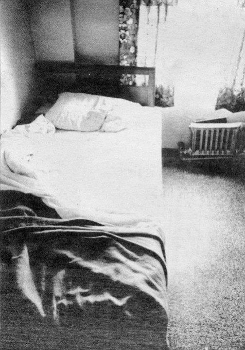 The sheets were a hard white color, covered by a dark, warm, rough cotton blanket and a heavy bedspread. The pillow never lost its full shape.
