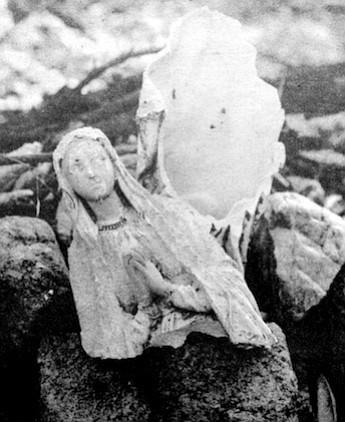 Broken statue of Virgin Mary