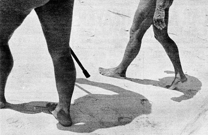 A couple walking at Black's Beach