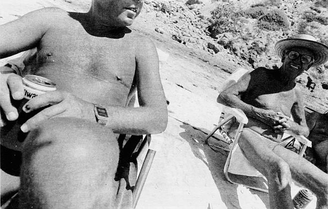 Two men enjoying the sun at Black's Beach
