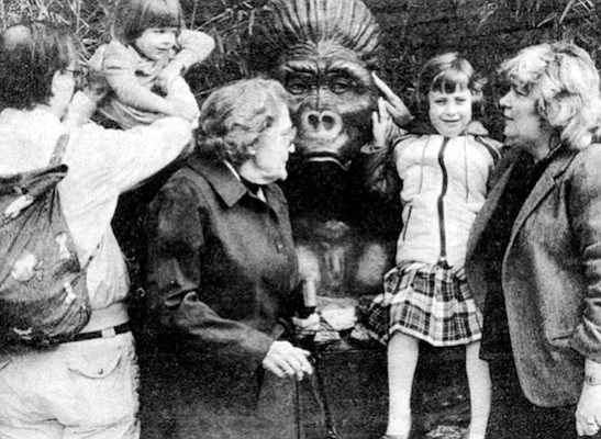 Family with gorilla statue. ''Man is the animal who knows he must die.""