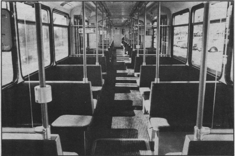"""Inside trolley car. """"In order to get the ridership on the trolley, they forced Greyhound out and cut bus service."""""""