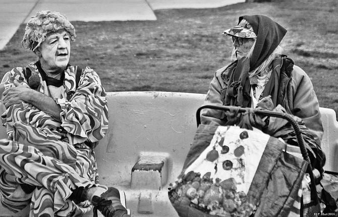 Conversation between travelers. Venice Beach, Ca.
