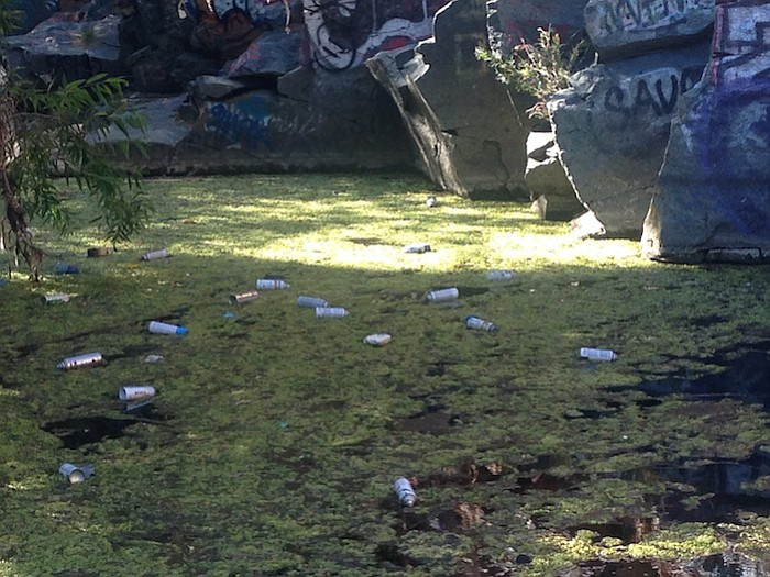 Discarded paint cans at Adobe Falls