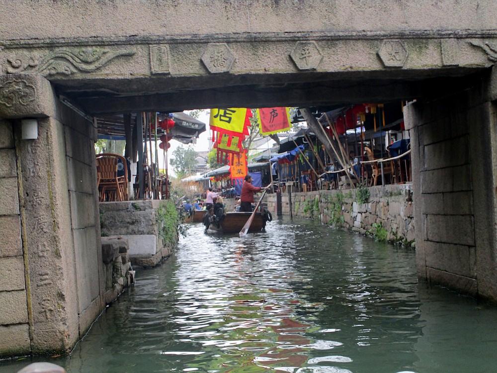 Passing under a bridge on a Tongli gondola.