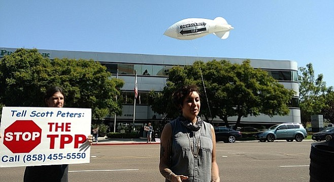 Anti-TPP activists Lizzy Jean and Chris McKay outside Scott Peters's La Jolla office