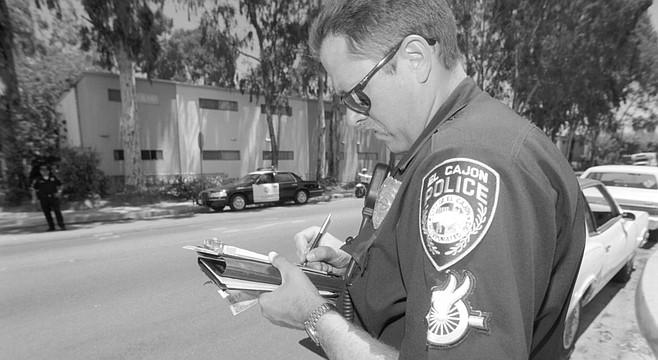 """El Cajon policeman on Lexington Avenue. Concedes El Cajon City Councilmember Todd Keegan, """"The valley floor needs a lot of improvement."""""""