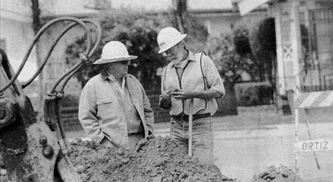 Larry Pierson (left), archeologist, and George Kennedy, paleontologist, examine a rock specimen - Image by Sandy Huffaker, Jr.