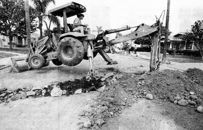 Mark Breshears on a backhoe fitted with sheep's foot