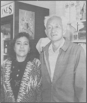 "Mr. Hui and waitress, Flor de Loto. ""The Tarahumara Indians say they're Mongolians who walked across the land bridge. The Mexicans cheated them, sold them rotten goods. The Chinese didn't cheat them. They liked the Chinese."""