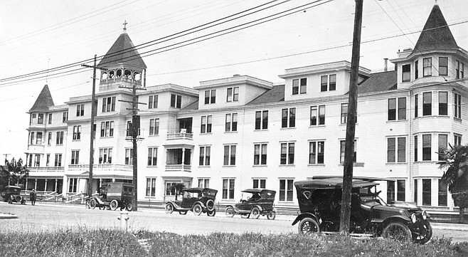"""St. Joseph's Hospital, 1921. Tent houses appear where the old men's dorm was, and across Eighth Avenue one can see the """"St. Joseph's Hospital Nurses Home"""" and the old men's dormitory building."""