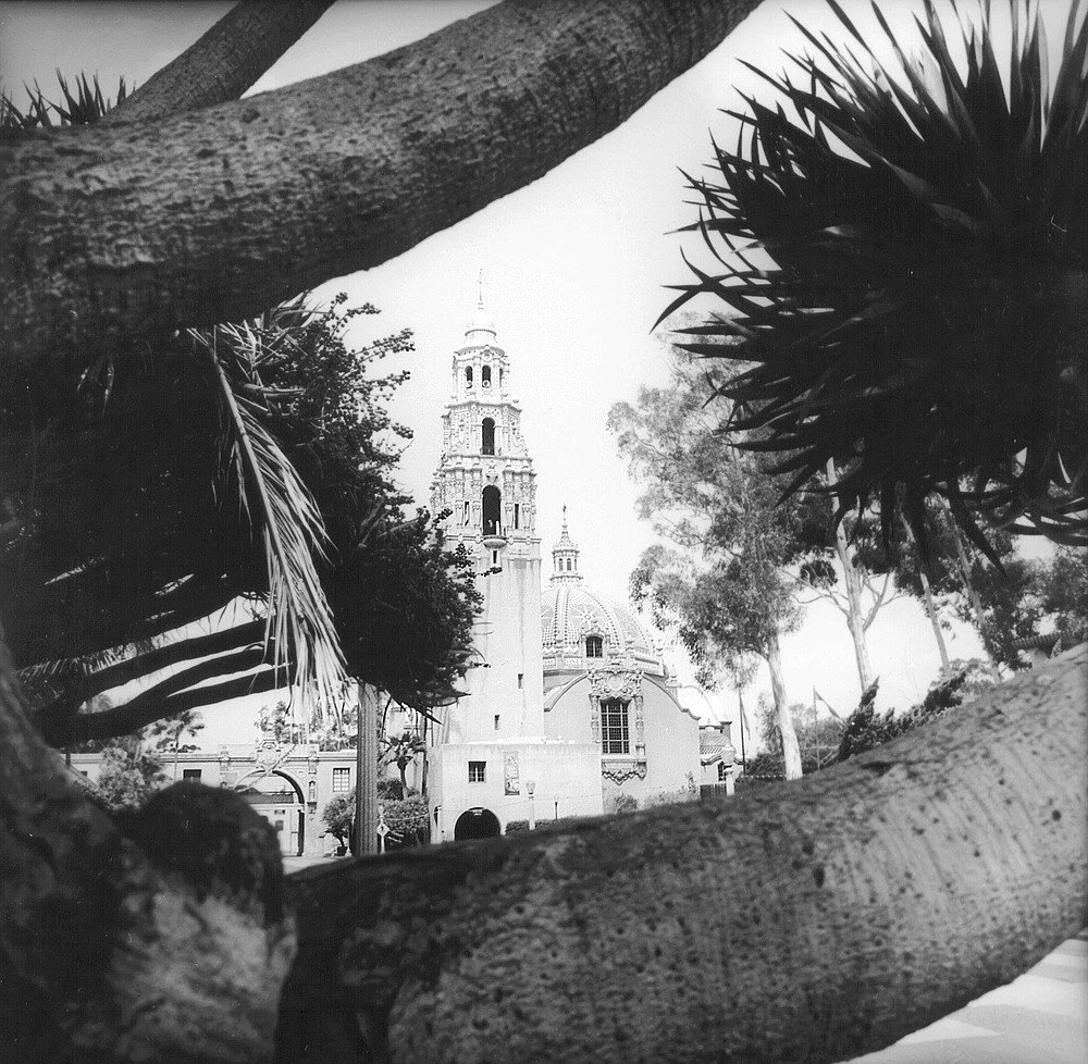 Museum of Man, Balboa Park,  a cathedral with stucco walls, arches, ironwork balconies, and ornate portals, thought to embody most of the elements of the so-called Churrigueresque school.