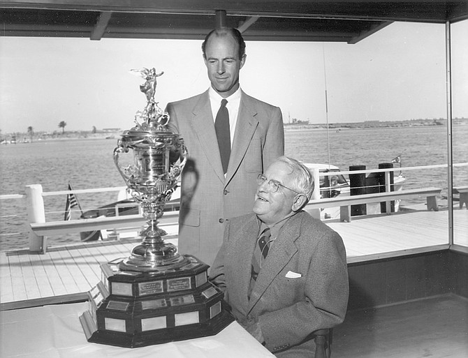 Gary Gould (standing) and Alonzo Jessop with yacht club trophy, 1953. Commodores of the club include Jessops, Goulds, Frosts, Frazees, Kettenburgs who have steered local history for the last 114 years.