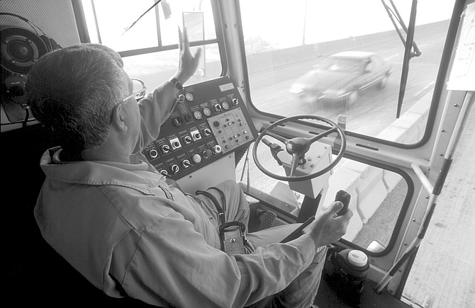 """Jerry driving the Zipper. Before the Zipper, the job was done by hand in an operation the crew called """"pull 'em and plug 'em."""""""