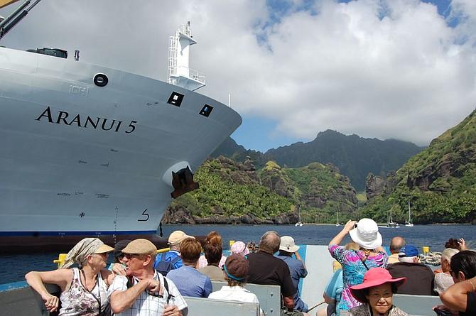 Aranui passengers prepare to make landfall at the Bay of Virgins, Fatu Hiva in the Marquesas Isles.