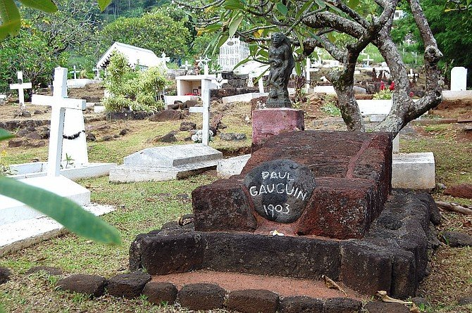 Painter Paul Gauguin's final resting place at the graveyard in Atuona, Hiva Oa, where Belgian singer Jacques Brel is also buried.
