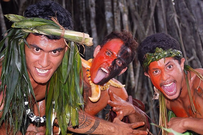 At the Kamuihei ceremonial site in Nuku Hiva, exuberant dancers pose after a riveting performance.