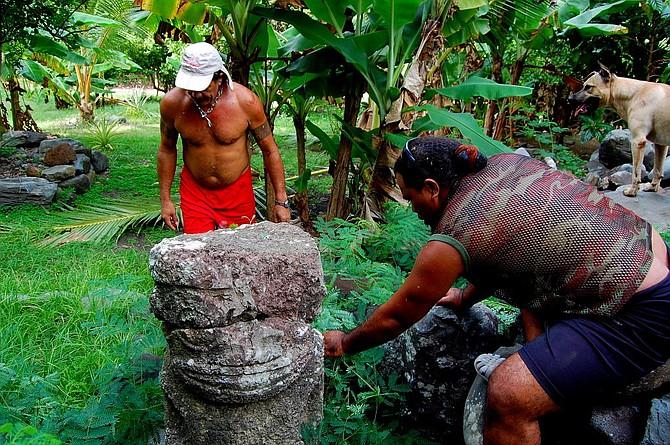 From left to right: Harris, Romain and Ganja inspect the large stone tiki at Hakamoui, Ua Pou.