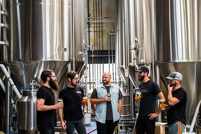Dead Feather moon bandmates gather at the Saint Archer brewery to make beer.