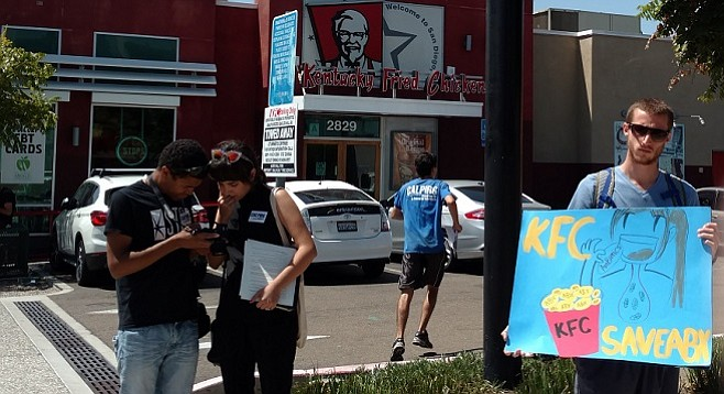 Antibiotic overuse activists outside KFC in North Park