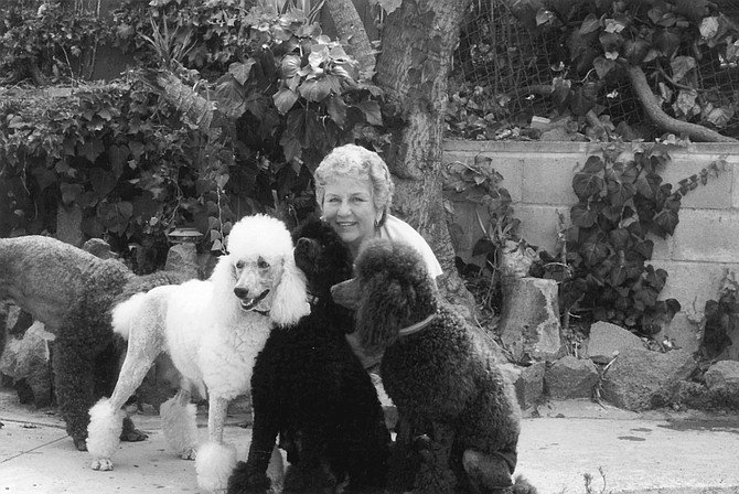 "Jan Gelin with Willow, Jet, and Tutti. ""I have dogs in La Jolla, Beverly Hills — very wealthy people buy my dogs."" - Image by Sandy Huffaker, Jr."
