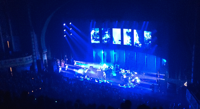 "Radiohead emerged from the silent darkness and began the night with ""Burn the Witch,"" the abrupt first single off their latest album, Moon Shaped Pool."