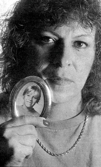 """Marlene Price with a photo of Amanda. """"They think they found her bicycle. They found it in Lake Jennings Park in Lakeside."""""""
