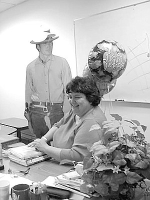 Ms. Solovay with balloons and Clint Eastwood cutout