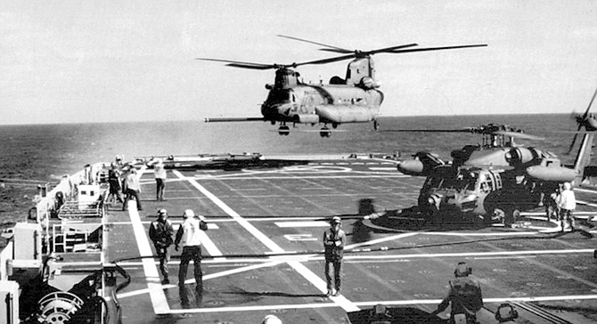 MH-47 (Chinook) landing.  If SEALs properly planned their operation, aircraft could be strafing, rocketing, and bombing within minutes of enemy contact.
