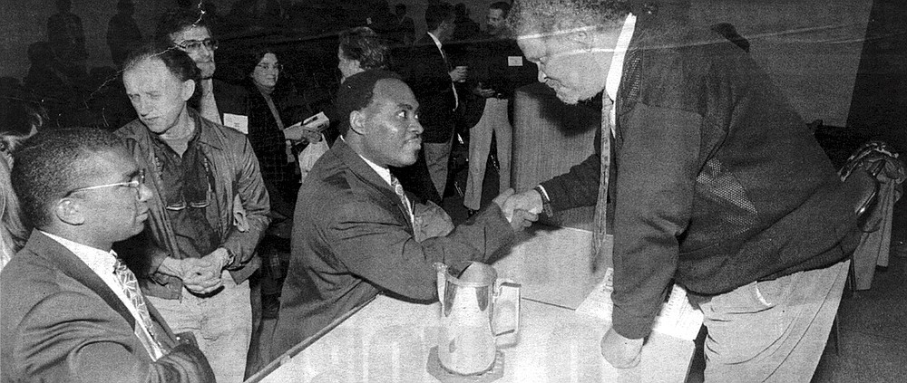Ishmael Reed (right) greets convention-goers