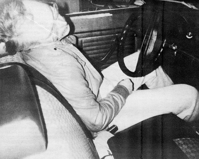 Coroner's photograph of Rodger Whitehead. Will reached through the open driver's side window to shake him, and Rodger's whole body moved. Rigor mortis.