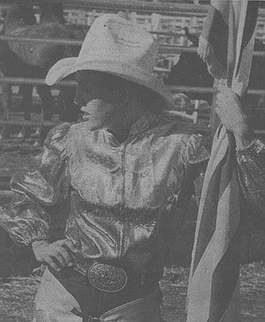 Rider holding the flag