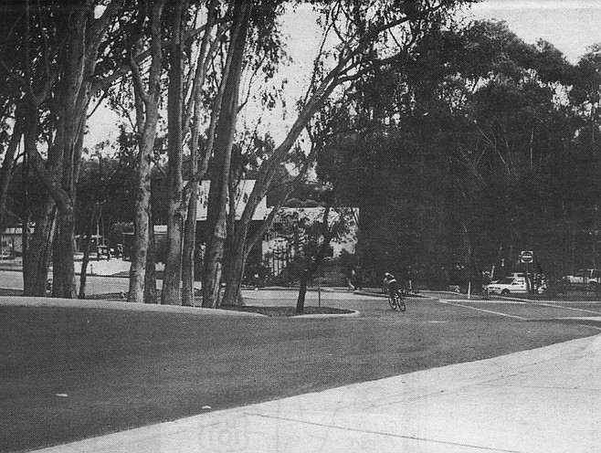 The Great Crossroads and traffic circle, west of the UCSD Price Center. Photo faces south-southeast from vantage point of old La Jolla Shores Drive. Old Route 101 on the right, Miramar Road in the left distance. Torrey Pines Road merges in the circle near right foreground.