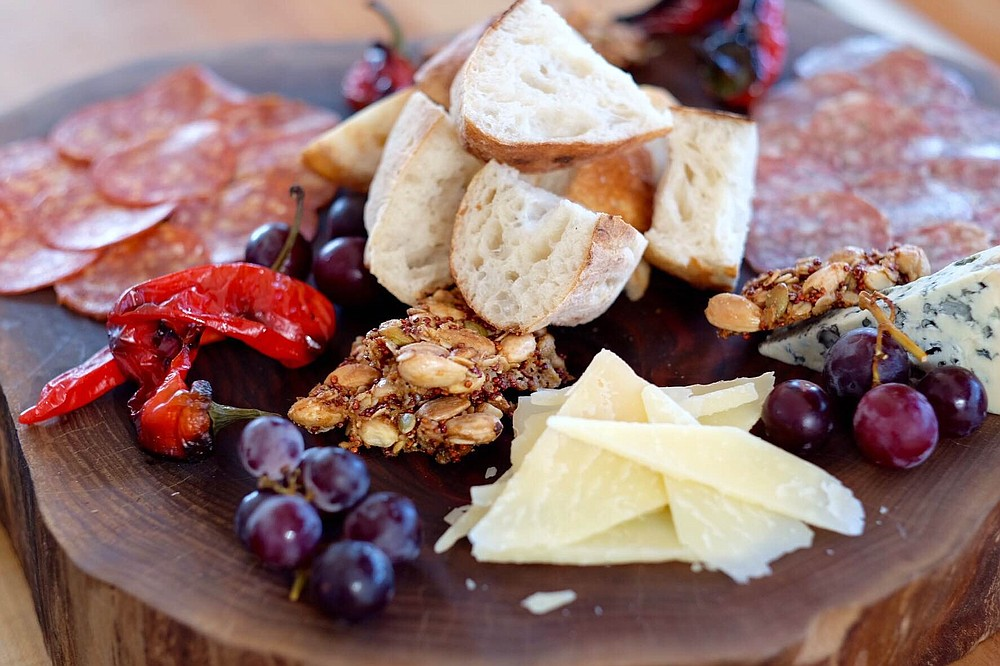 House-made charcuterie with seasonal, local meat, cheese, fruits, and vegetables