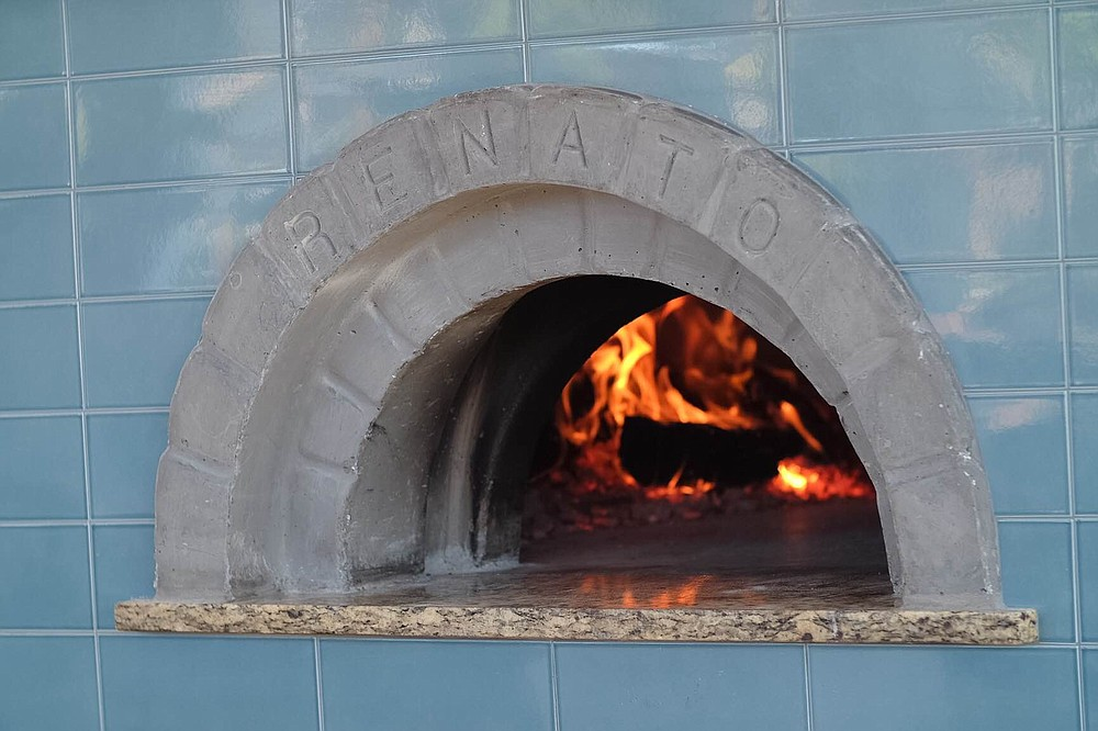 Tribute's 1500-lb wood-fired Renato oven burns white oak and runs through a filtration system that converts smoke into harmless water vapor