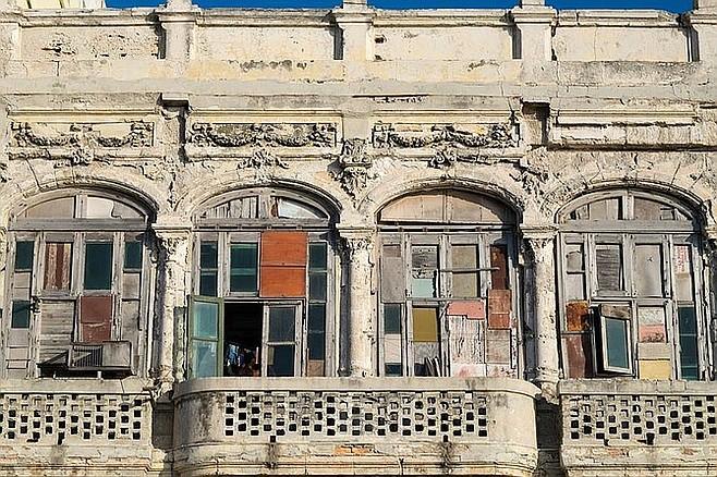 Boarded-up windows on a Havana building.