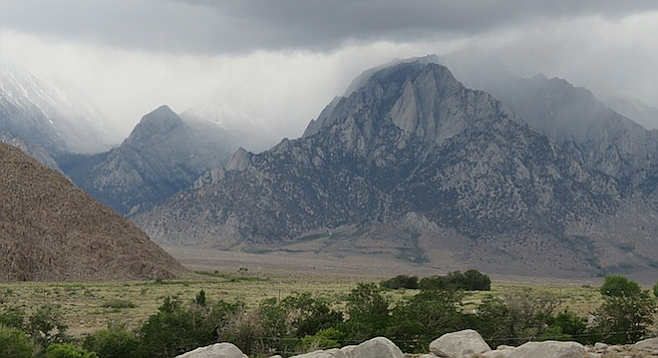 A storm rolls in over the neighboring Sierra Nevadas.