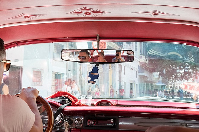 Arrival in Havana via classic-car taxi.