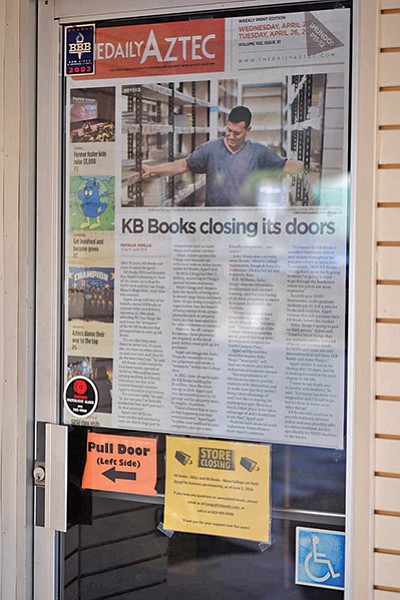 Daily Aztec article on the door of KB Books