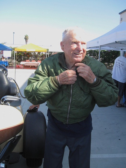 Retired Navy captain Royce Williams arrived by motorcycle.