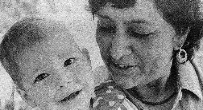Hemlata Momaya (right) with Sasha, a Romanian child in the U.S. for less than two weeks