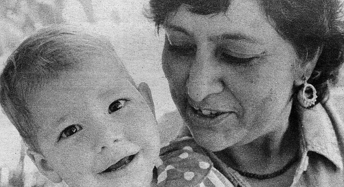 Hemlata Momaya (right) with Sasha, a Romanian child in the U.S. for less than two weeks - Image by Erik Hanson
