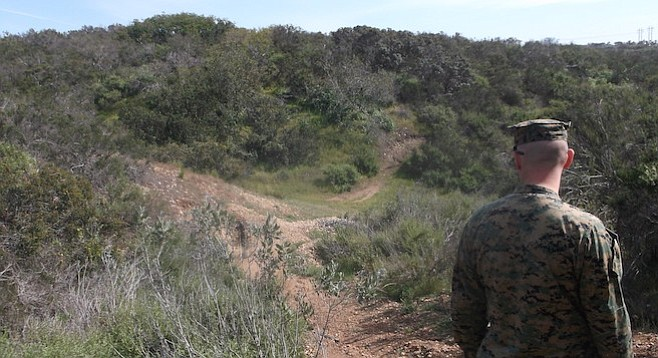 A Marine and a trail made by base intruders