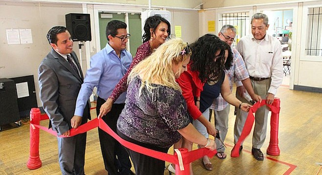 On August 26th, a community steering committee and others cut the ribbon on their air-monitor project