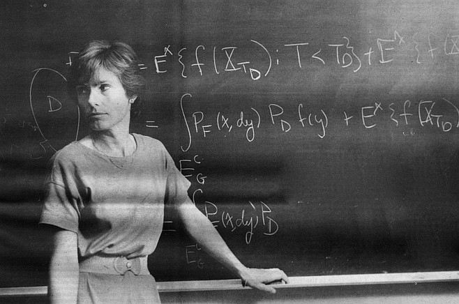 A teacher in front of her chalkboard