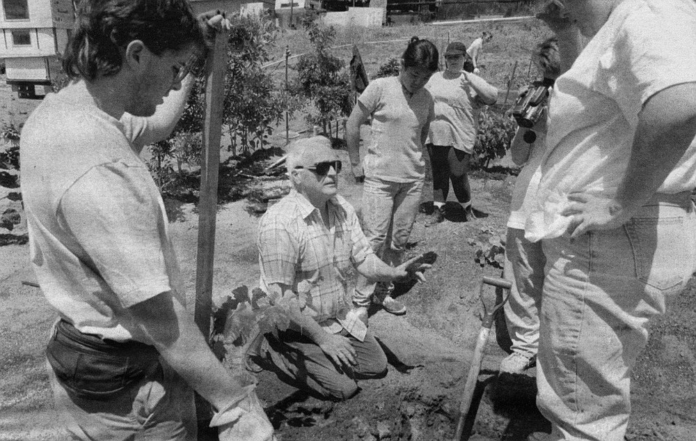 John McMillin (in sunglasses) explains planting techniques to his students at Rancho Sordo Mudo, 1993